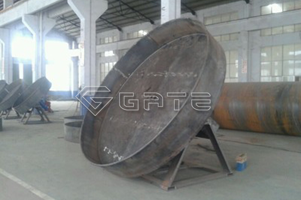 How does the Gate disc granulator granulate fertilizer?